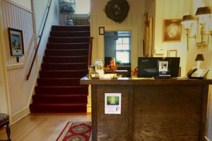 Historic mansion, motel, entry way | The Hartland Inn | New Meadows, ID