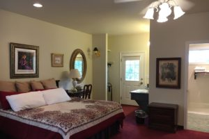 king suite, king bed, antique furnished