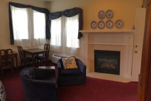 queen suite, fireplace, lounge chairs, scenic view