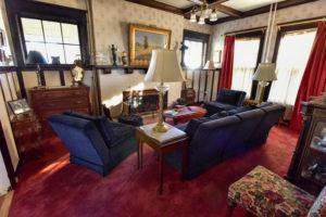 den, lounge, sitting room, fireplace, sofa