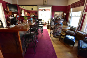 beer & wine bar, barstools, chairs, tables, cozy